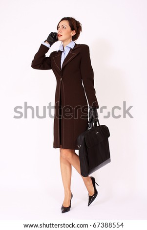 Attractive woman walking with the briefcase - stock photo