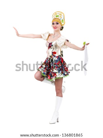 Attractive woman wearing a folk russian dress dancing against isolated white background - stock photo