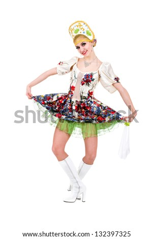 Attractive woman wearing a folk ukrainian dress dancing against isolated white background