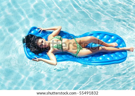 Beautiful woman dressed sexy army uniform stock photo for Swimming pool bed