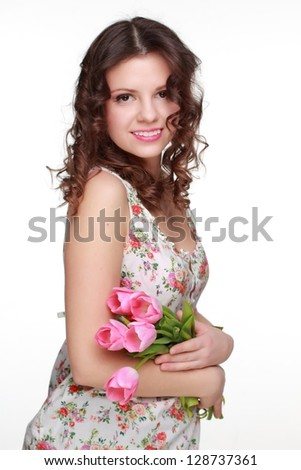 Attractive woman wearing clothes with floral ornament on Holiday theme/Spring flowers pink tulips - stock photo