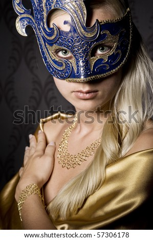 attractive woman wearing mask, over wallpaper background - stock photo