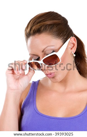 Attractive woman wearing sunglasses and whistling trying to act cool. - stock photo