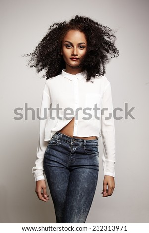 attractive woman with a blowing hair looking at camera  - stock photo