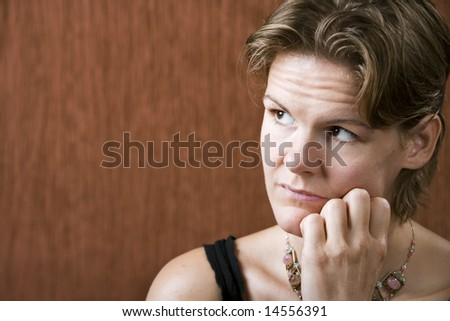 Attractive woman with a neutral look on her face - stock photo