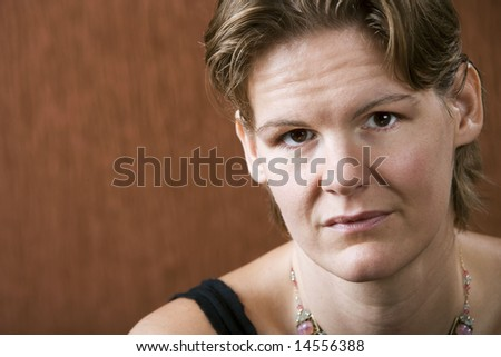Attractive woman with a stern look on her face - stock photo