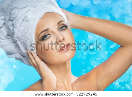 Attractive woman with a white towel on the head - stock photo