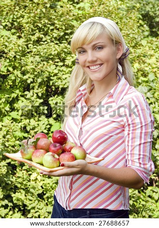 attractive woman with apples in garden