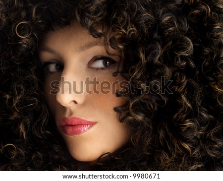 attractive woman with beautiful, thick hair. Woman wearing a huge afro wig. Model in a big afro wig - stock photo