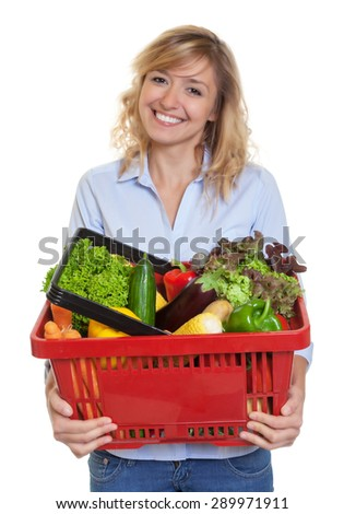 Attractive woman with blonde hair buying healthy food - stock photo