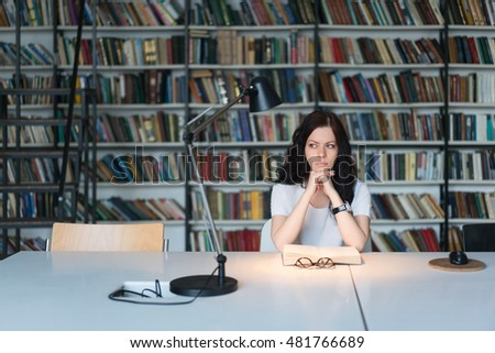 Attractive woman with book indoors