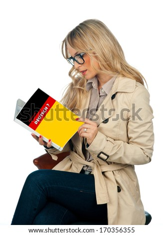 attractive woman with book learning german language - stock photo