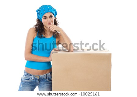 Attractive woman with box making a removal - stock photo