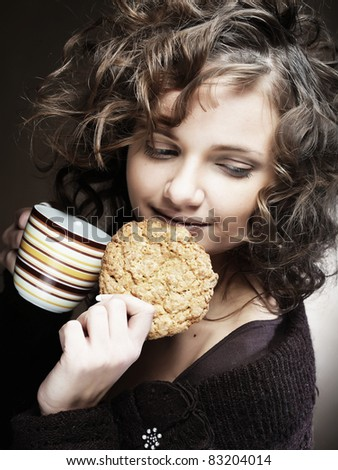 attractive woman with coffee and cake - stock photo