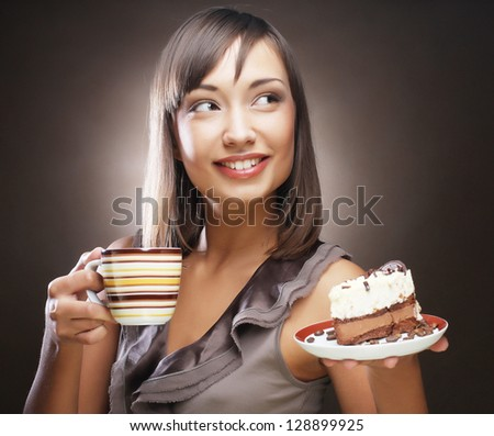 attractive woman with coffee and dessert - stock photo