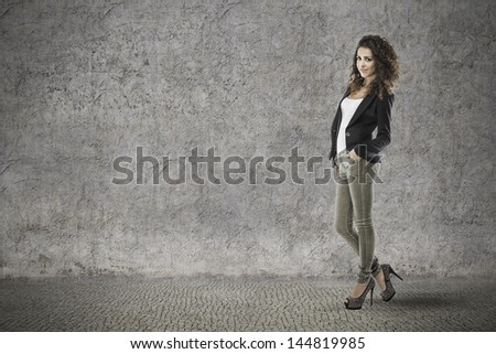 attractive woman with curly hair on vintage grunge background
