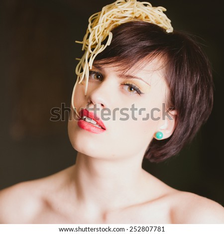 attractive woman with eating spaghetti. Concept idea  - stock photo