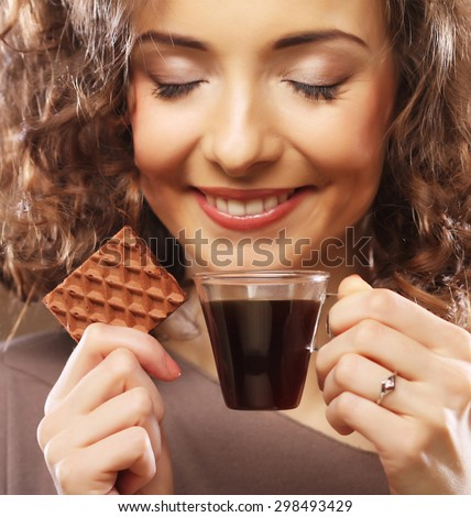 attractive woman with espresso coffee and cookies - stock photo