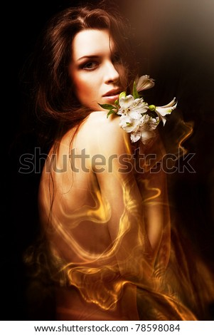 attractive woman with flowers and honey - stock photo