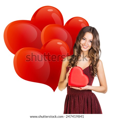 Attractive woman with gift box in form of heart - stock photo