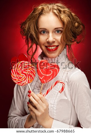 attractive woman with heart caramel over red background