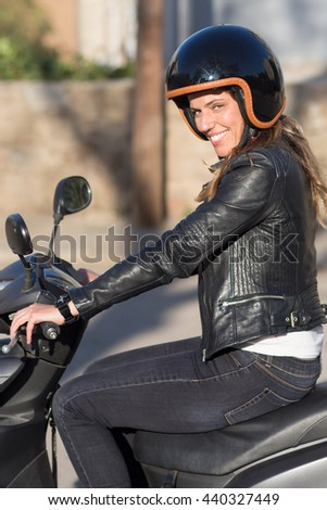 Attractive woman with helmet on motor bike driving