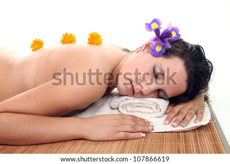 attractive woman with hot stones treatment at a spa