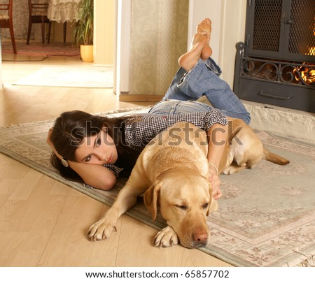 Attractive woman with labrador the dog on the flor - stock photo