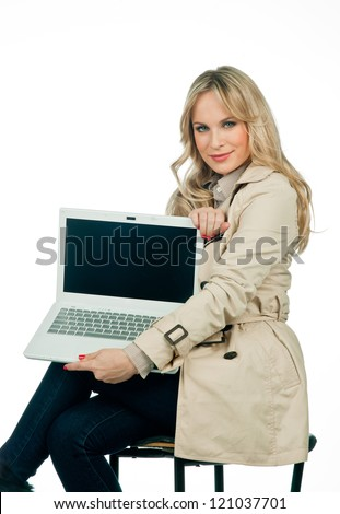 attractive woman with laptop showing blank desktop screen - stock photo