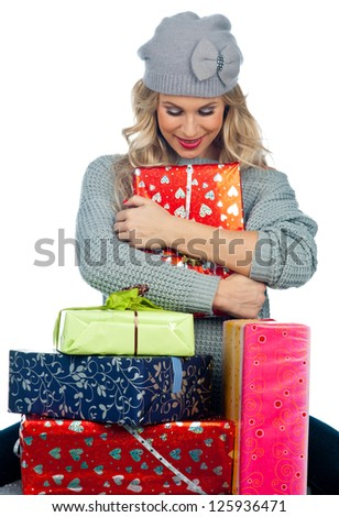 attractive woman with lot gifts and presents - stock photo
