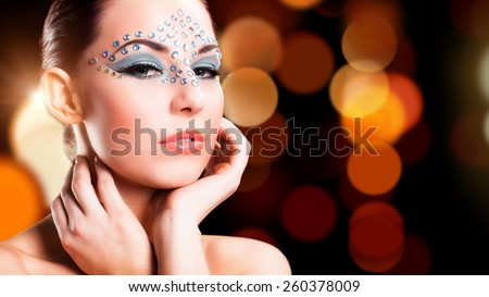 attractive woman with night lights - stock photo