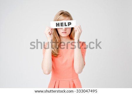Attractive woman with paper blank closing her eyes with word Help. She feels sad, sad and has bad vision - stock photo
