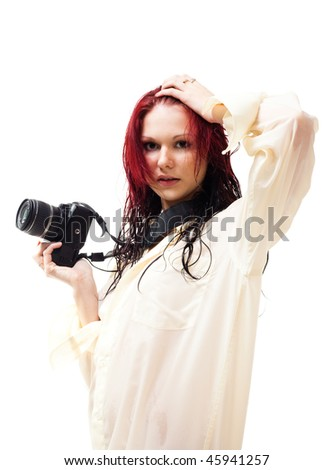 Attractive woman with photo camera  in wet clothes, isolated on white