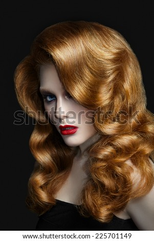 Attractive woman with red hair on black background