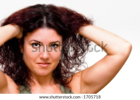 Attractive woman with red hair on white background - stock photo