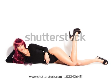 attractive woman with red long wig in black body underwear and high heels, lie down, full body shot, studio white