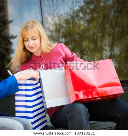 Attractive woman with shopping bags. Shopping.