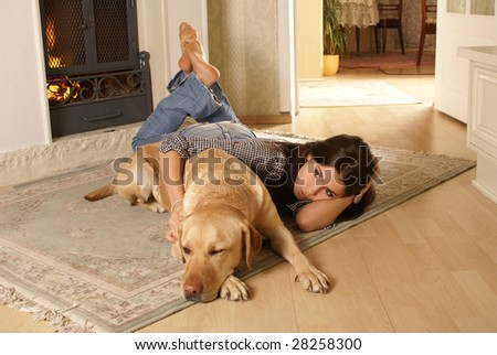 Attractive woman with the dog on the flor - stock photo