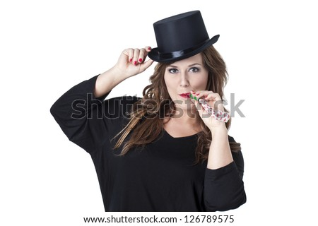 Attractive woman with top hat and party whistle isolated in a white background