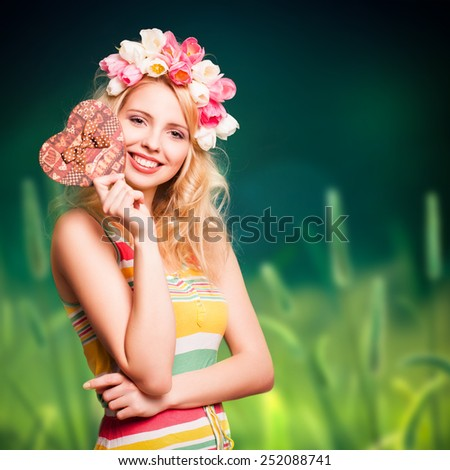 attractive woman with tulip hair decoration and a present - stock photo