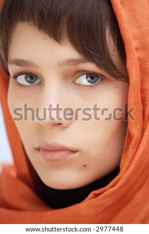 attractive woman with veil in the head a over blue background - stock photo