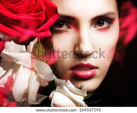 attractive woman with white and red roses - stock photo