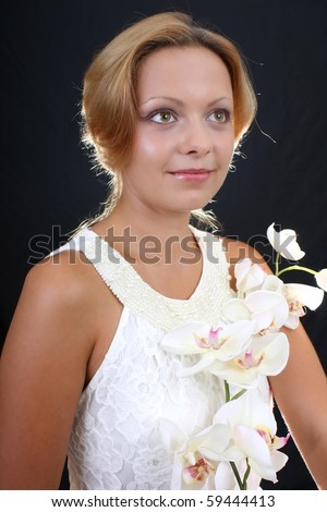 attractive woman with white orchid - stock photo