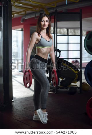 Attractive woman working out in a gym