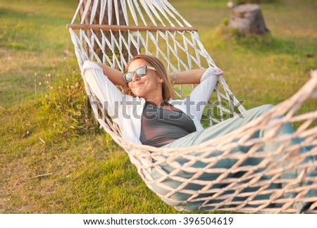 attractive woman 30 years old in a hammock. Outdoor - stock photo