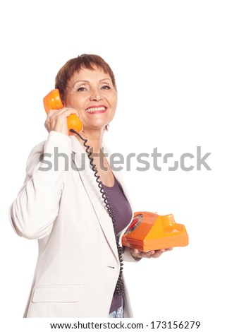 attractive woman 50 years with vintage telephone isolated on white background - stock photo
