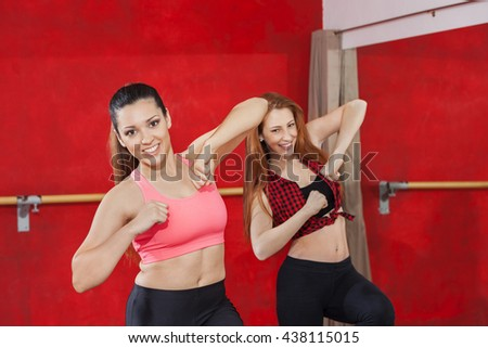 Attractive Women Dancing Together In Zumba Class - stock photo