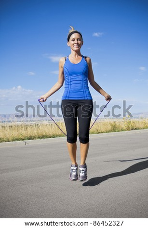 Attractive Women Exercising and Jumping Rope - stock photo