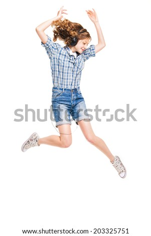 attractive women with headphones in dancing motion over white background - stock photo