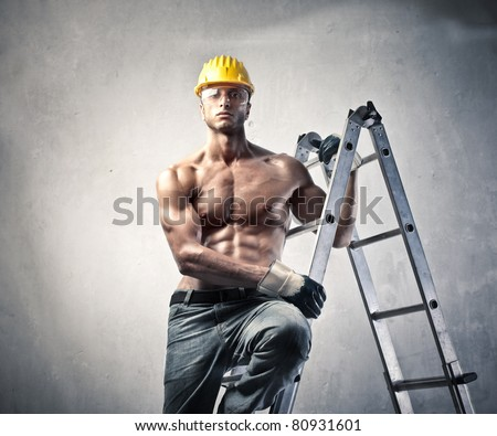 Attractive worker on a ladder - stock photo